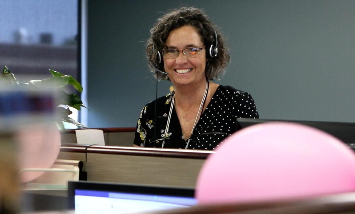 A PERA customer service representative, smiling