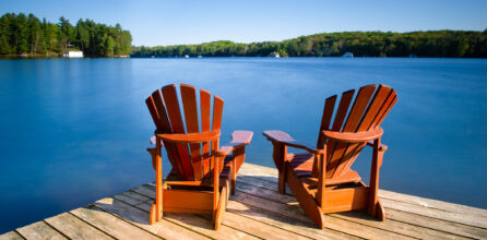 Adirondack chairs on a wooden pier